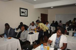 Some of the guests at the stakeholders forum taking light refreshments as discussions continue amongst themselves,